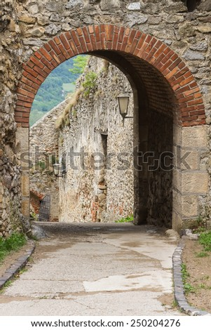 Brick vaults above the arch on pass through the stone ramparts of the castle Trencin in Slovakia. The old road went off along the wall - stock photo