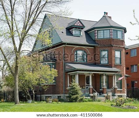 Brick Victorian House in Springtime - stock photo
