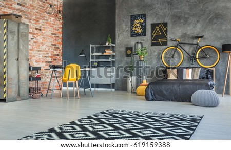 Brick Wall And Hipster Furniture In Bedroom Interior