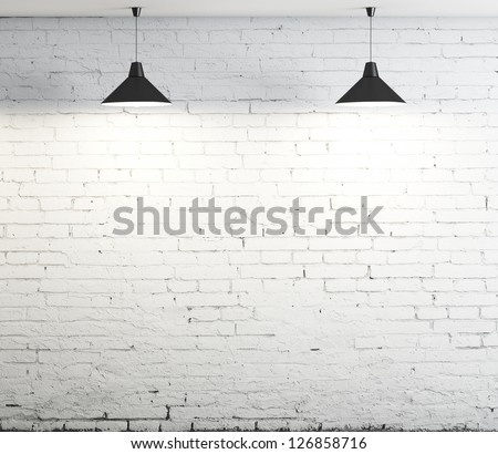 brick wall and two ceiling lamp - stock photo