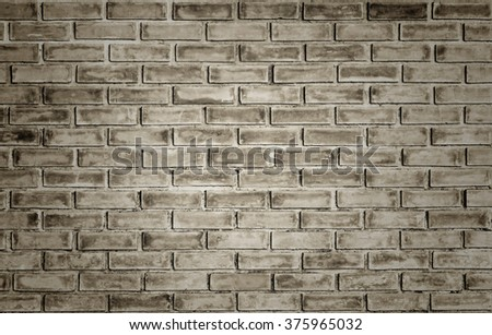 brick wall background in vintage style.concept.Abstract weathered texture stained old stucco brick wall background in room, blocks of stonework color horizontal architecture wallpaper - stock photo