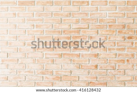 brick wall background vintage style. Sepia concept.Abstract weathered texture stained old stucco brick wall background room,blocks of stonework color horizontal architecture wallpaper color orange. - stock photo