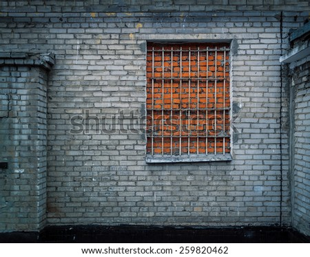 Brick wall background with window made of bricks. Ultimate security against burglary. - stock photo