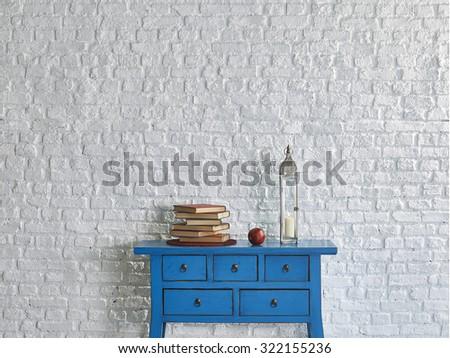 brick wall blue desk books concept interior style - stock photo
