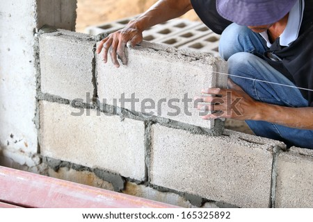 Brick wall construction for house building  - stock photo