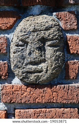 Brick wall decoration - ancient american stone bas-relief - stock photo