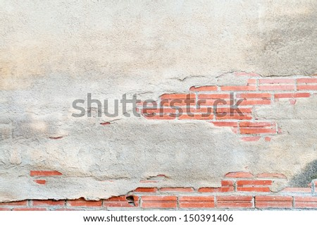 Brick wall destroyed by time and weather conditions - stock photo