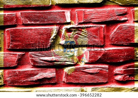 Brick wall Montenegro flag with some cracks and vintage look