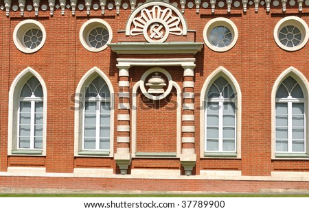 Brick wall of palace in Tsaritsino park, Moscow. There are windows and various architectural details on it - stock photo