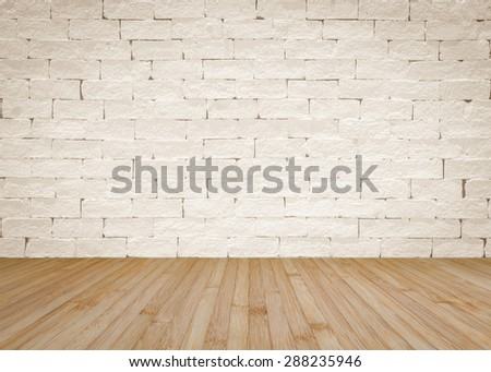 Brick wall painted in light sepia cream beige color tone with wooden floor textured background in natural yellow cream brown color tone  - stock photo