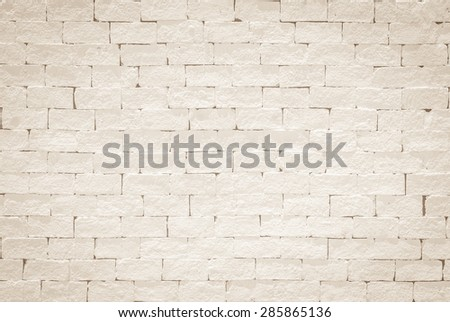 Brick wall pattern texture background painted in light cream color tone: Empty masonry wall textured backdrop in beige colour  - stock photo