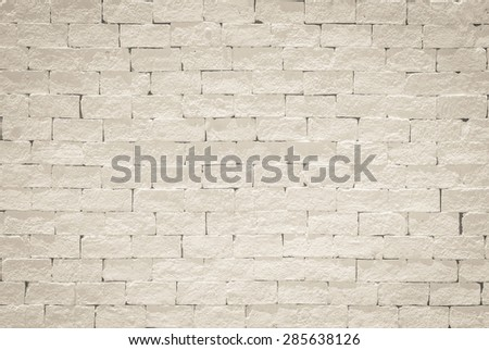 Brick wall pattern texture background painted in light sepia grey color tone: Empty masonry wall textured backdrop in sepia beige colour  - stock photo