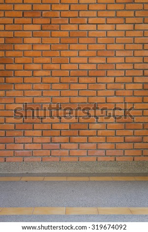 brick wall texture background and small gravel stone washed floor