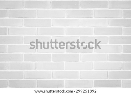 Brick wall texture pattern background in natural light white grey color tone: Masonry brick work wall detail textured backdrop with vignette  - stock photo