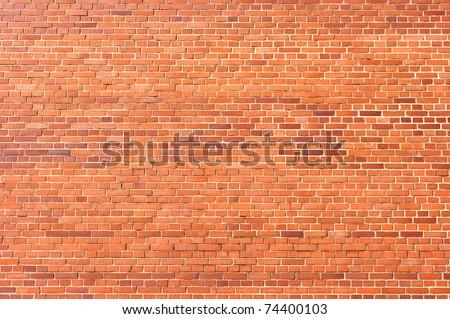 Brick wall texture - small red bricks - stock photo