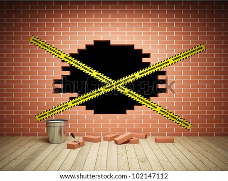 Brick wall with a hole is under construction - stock photo