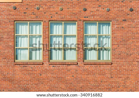 brick wall with curtain windows  ,surface  of cargo,warehouse in old industrial  zone. - stock photo