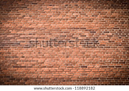 Brick wall with gradient for background usage - stock photo