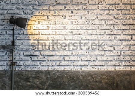 brick wall with lighting bulb and blank space for text or object - stock photo