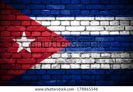 Brick wall with painted flag of Cuba - stock photo