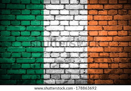 Brick wall with painted flag of Ireland - stock photo
