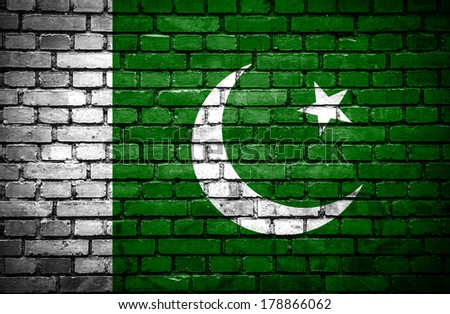 Brick wall with painted flag of Pakistan - stock photo
