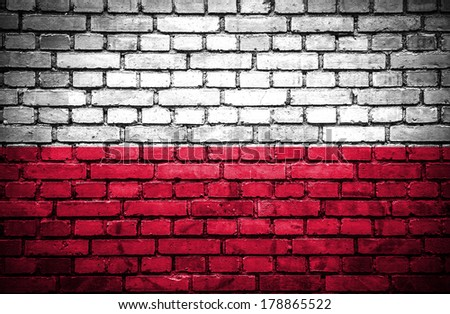 Brick wall with painted flag of Poland - stock photo