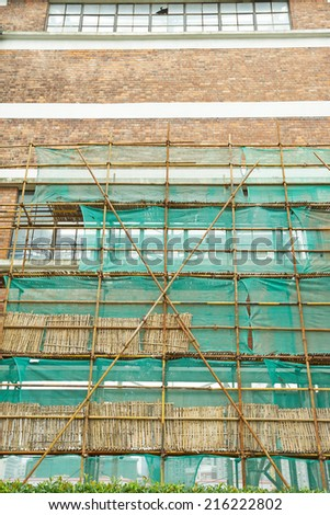 brick wall with scaffolding, factory - stock photo