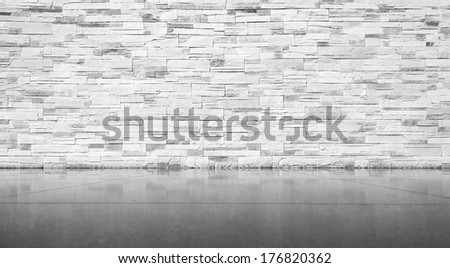 Brick wall with tiled floor background texture in grey colors - stock photo