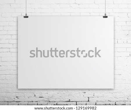 brick wall with white poster - stock photo