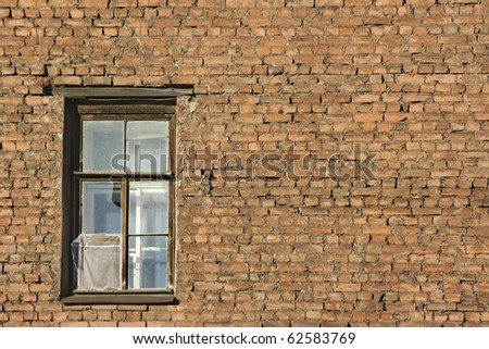 brick wall with window - stock photo