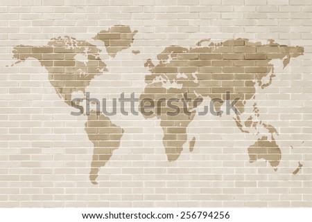 Brick wall with world map  - stock photo