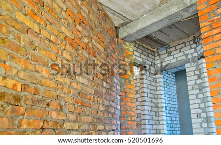 Brick walls in the house under construction