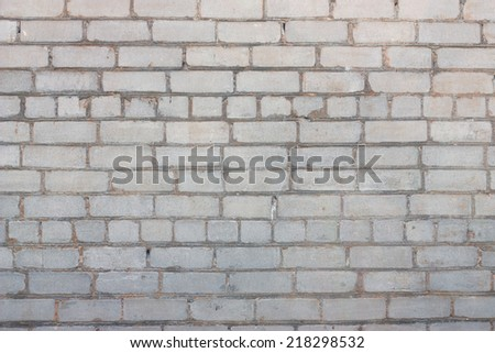 Brick white-gray wall