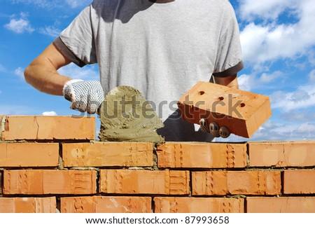 bricklayer on sky - stock photo