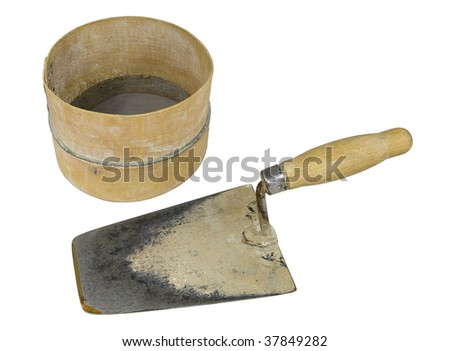 Bricklayer tools - trowel and sieve