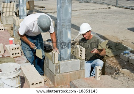 Bricklayers Installing Soldiers - stock photo