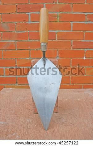 Bricklayers trowel. - stock photo