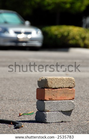 bricks and car, conceptual of opposition / enemy - stock photo