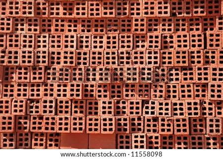 Bricks stockpiled at a construction. Bricks structure - stock photo