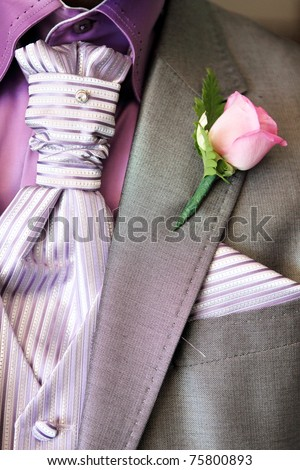 Bridal boquette with pink roses on pink and purple material - stock photo