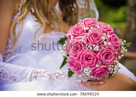 Bridal bouquet in the hand of bride