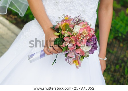 bridal bouquet in the hands of the wedding. - stock photo