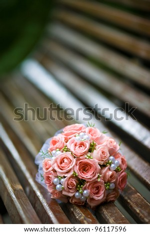 bridal bouquet is on the bench - stock photo