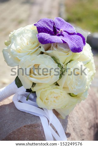 Bridal bouquet made from white roses with lilac orchid - stock photo