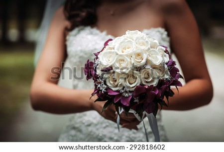 bridal bouquet of flowers in hands of the bride - stock photo