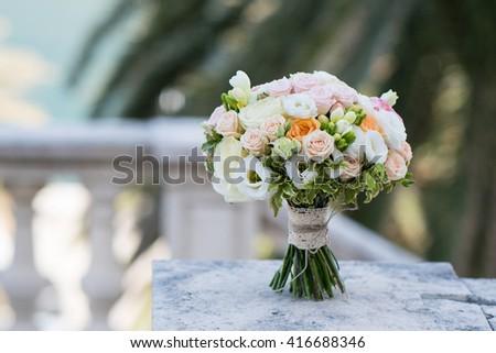bridal bouquet of roses, freesia, eustoma - stock photo