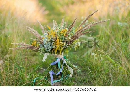 Bridal bouquet on the nature of wildflowers - stock photo