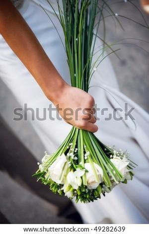 Bridal bouquet on wedding day - stock photo