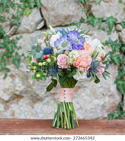 bridal bouquet peachy with blue - stock photo